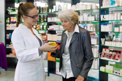 pharmacist looking at a prescription